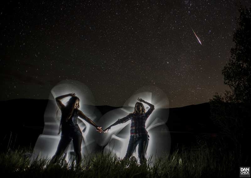 Nancy and Theresa dancing under a meteor in Colorado